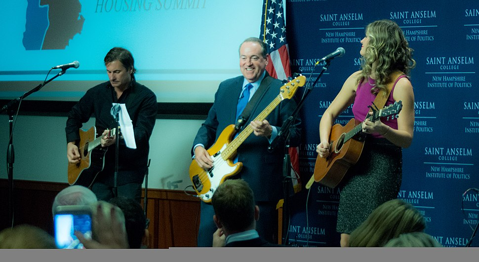 Former Arkansas Governor Mike Huckabee play bass guitar with recording artist Ayla Brown in 2015
