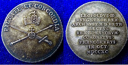 "Coronation in Frankfurt am Main 9 October 1790. Silver strike of a coronation coin with Leopold's motto ""pietate et concordia"" above the Imperial Regalia. Frankfurt am Main 1.5 Ducat 1790 Silver Strike Coronation Coin Leopold II.jpg"