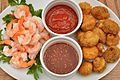 Fried mushrooms and cooked shrimp with sauces.jpg