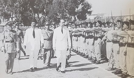 President Chehab between 1960 and 1964 Fuad Chehab & Emir Majid Arslan reviewing the army.jpg
