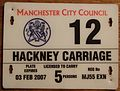 GREAT BRITAIN, ENGLAND, MANCHESTER 2007 -HACKNEY CARRIAGE (TAXI) LICENSE SUPPLEMENTAL PLATE - Flickr - woody1778a.jpg