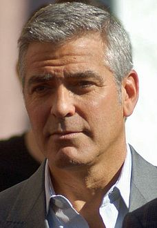 Clooney at a ceremony for John Wells to receive a star on the Hollywood Walk of Fame in January 2012