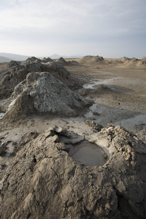Mud volcano Landform created by the eruption of mud or slurries, water and gases