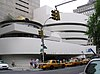The Guggenheim museum with taxis in the foreground