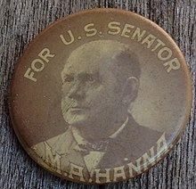 A late 19th century celluloid political button in black and white; on the top