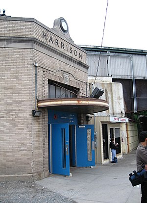 Harrison station (PATH) - Station entrance at street level. Note the Pennsylvania Railroad logo over the front door.