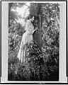 Helen Keller, full-length portrait, standing by tree, facing right LCCN90715105.jpg