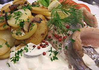 """Pomeranian cuisine - Pomeranian cuisine is famous for its great variety of fish dishes, such as Herring in Cream (""""Sahnehering"""", pictured) and Bismarck Herring."""