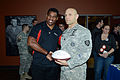 Herschel Walker, Heisman trophy winner and former NFL player, shakes hands with Oregon Army National Guard Captain Vincent Habeck.jpg