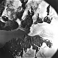 Holgate Glacier, terminus of tidewater glacier, mountain glaciers with icefall, and bergschrund, August 23, 1979 (GLACIERS 6564).jpg
