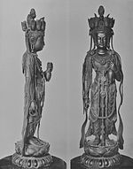 Front and profile view of a standing statue with her left arm bend forward. On the head there are small heads visible facing in various directions.
