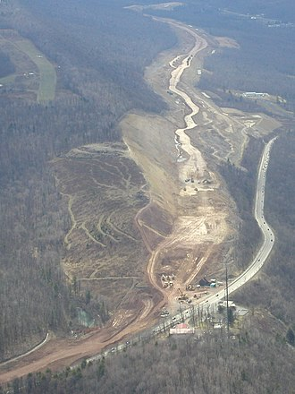 Interstate 99 - 2002 photo of the I-99 excavation, looking south from Julian at the area where acidic rock was exposed on Bald Eagle Mountain