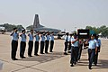 IAF officials paying tribute to mortal remains of accident causalities of AN-32 aircraft.jpg