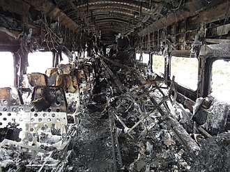 Valhalla train crash - Interior of the lead car some time after the accident, showing extensive fire damage and the displaced third rail sections