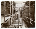Interior work - wooden scaffolding along two brick walls (NYPL b11524053-489639).tiff