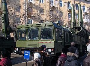 9K720 Iskander - Iskander missiles (right) and an OTR-21 Tochka missile (left) on static display