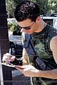 JC Chasez signing an autograph (cropped).jpg