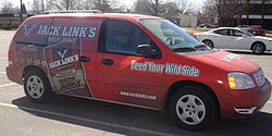 Minivans are popular as rolling advertisements, as seen in this image, of a Ford Freestar advertising Jack Links Beef jerky.