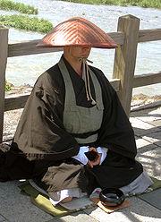 A monk by the Katsura River in Arashiyama.
