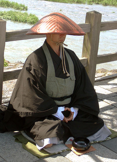 A monk by the Katsura River in Arashiyama Japanese buddhist monk by Arashiyama cut.jpg