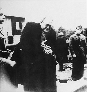 The Holocaust in the Independent State of Croatia - A Jewish prisoner is forced to remove his ring upon arrival in the Jasenovac concentration camp.