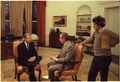 Jimmy Carter prepares for an interview with John Chancellor while Gerald Rafshoon stands by. - NARA - 183019.tif