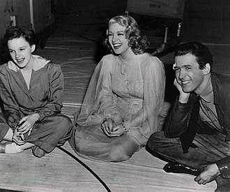 Lana Turner - Turner (center) with Judy Garland and James Stewart on the set of Ziegfeld Girl (1941), which precipitated her rise at MGM