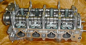 Variable valve timing - Cylinder head of Honda K20Z3. This engine uses continuously variable timing for the inlet valves