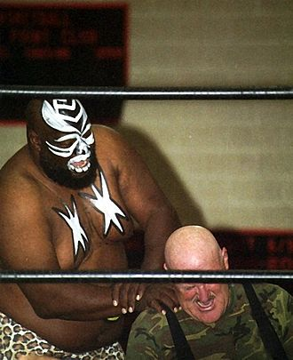 Kamala (wrestler) - Kamala performing a nerve hold on Sgt. Slaughter.