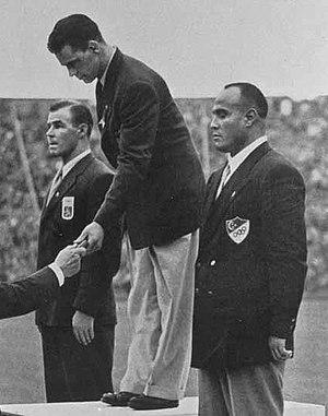 Karl-Erik Nilsson (wrestler) - Nilsson (center) at the 1948 Olympics