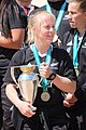 Kendra Cocksedge holding Women's Rugby World Cup trophy.jpg