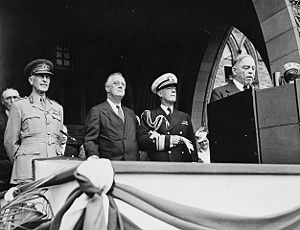 Wilson Brown (admiral) - (L-R): The Earl of Athlone, Franklin D. Roosevelt, Rear Admiral Wilson Brown, William Lyon Mackenzie King (at podium) at Ottawa, 25 August 1943