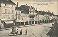 La Grande Rue à Remiremont avec les arcades et la statue du Volontaire.jpg
