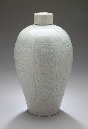 Qingbai ware - Lidded plum vase (meiping) with lotus sprays, Qingbai ware, Southern Song period. Typically, the glaze has collected in the carved indentations, where the colour is stronger.