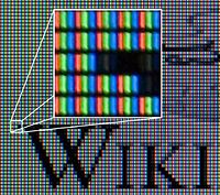 Wikipedia's logo displayed on an LCD monitor.