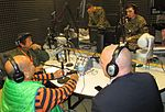 Local radio, music personalities visit AFN 141222-M-CE123-312.jpg