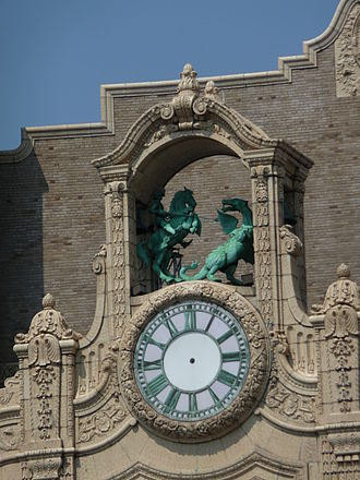 Loew's Jersey Theatre - Clock tower on the Loew's Jersey Theatre depicting St. George and the dragon