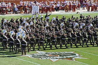 Traditions of Texas A&M University - 2006 Lone Star Showdown - Fightin' Texas Aggie Band marches past the Lone Star Showdown logo in Darrell K. Royal Texas Memorial Stadium