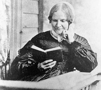 Lydia Maria Child - Child in 1870, reading a book.