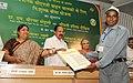 M. Veerappa Moily presenting the insurance certificate, at the launch of the IGL Suraksha Yojna, in New Delhi. The Chief Minister of Delhi.jpg