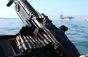 Belt (firearms) - An M60 machine gun belt loaded with 7.62×51mm NATO cartridges, aboard a U.S. Navy patrol craft.