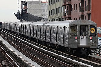 W (New York City Subway service) - A train made of R68 cars in W service at 39th Avenue in Queens, bound for Astoria–Ditmars Boulevard.
