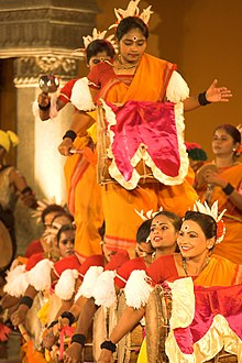Colourfully-dressed women dancing