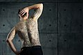 Man with a backpiece Christian and Enlightenment tattoo. Michael and the Dragon. Color.jpg