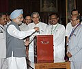 Manmohan Singh casting his vote in the Presidential election at Parliament House, in New Delhi on July 19, 2012. The Union Minister for Parliamentary Affairs and Water Resources, Shri Pawan Kumar Bansal is also seen.jpg