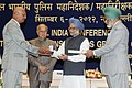 Manmohan Singh presented the Police Medal, at the All India Conference of Directors GeneralInspectors General of Police -2012, in New Delhi. The Union Home Minister, Shri Sushil Kumar Shinde and the Director.jpg
