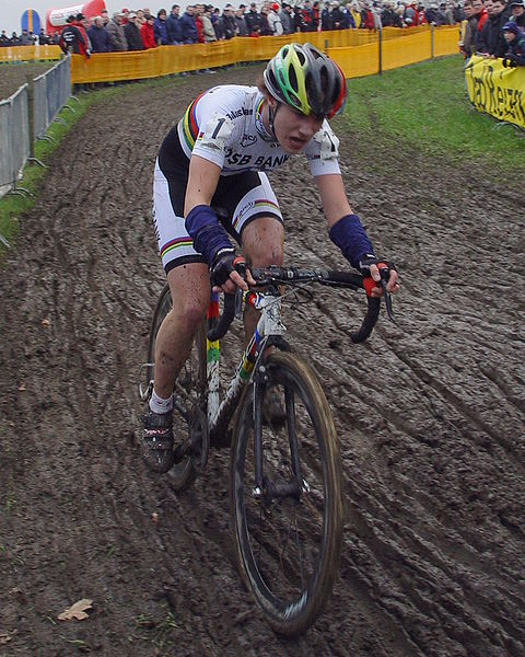 Marianne Vos cycling on a mud track in 2007.