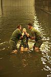 Marines and sailors get baptised aboard the USS Makin Island 141121-M-HU038-531.jpg