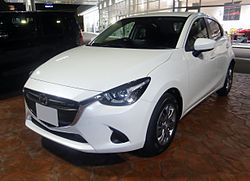 Mazda DEMIO 13S (DJ) at night front.JPG