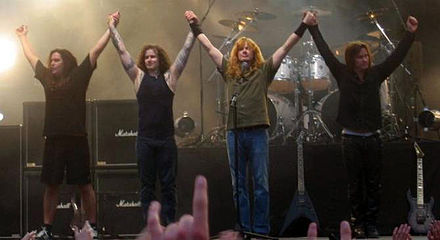 Megadeth's 2004–2006 lineup: Shawn Drover, James MacDonough, Dave Mustaine, and Glen Drover Megadeth at Sauna crop.jpg